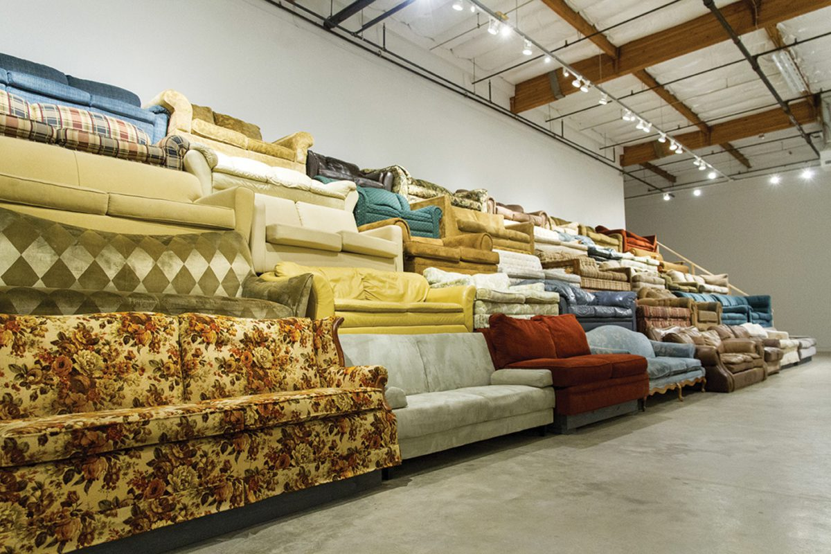 Nate Page - couchbleachers, 2015. Wood, Locally collected couches, 15'H x 55'W x 15' D. Verge Center for the Arts, Sacramento CA.