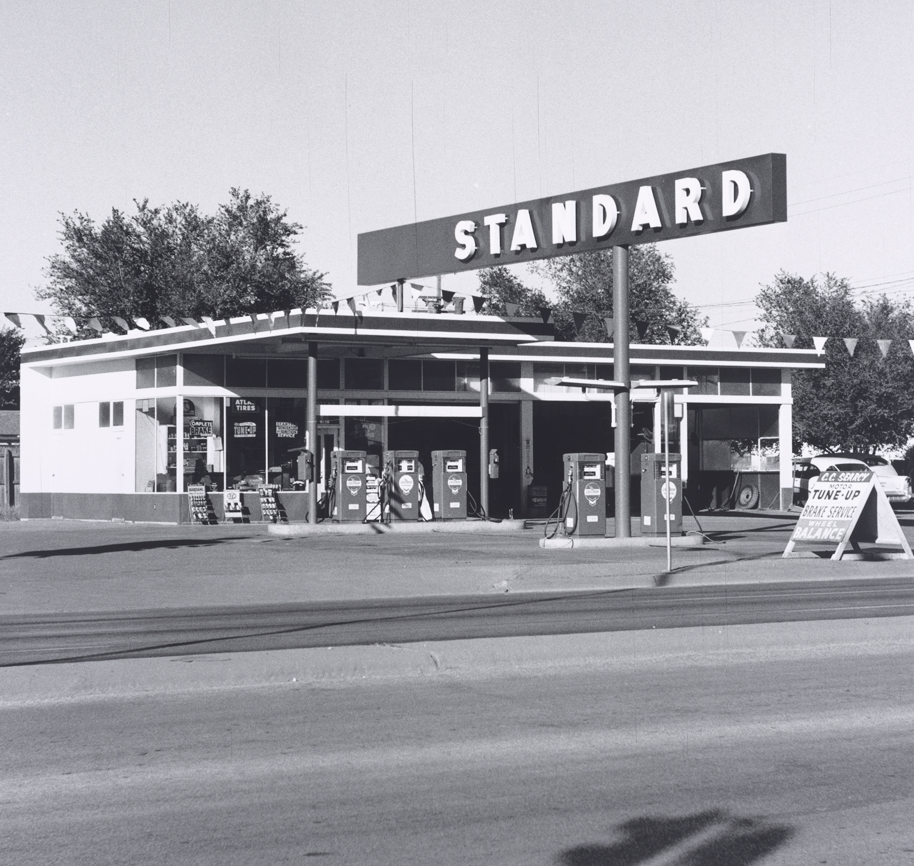 Ed Ruscha. Standard Station, Amarillo, Texas, 1962 Gelatin silver print. 4 15/16 x 5 1/16 (12.5 x 12.9 cm) Whitney Museum of American Art, New York, Purchase with funds from The Leonard and Evelyn Lauder Foundation, and Diane and Thomas Tuft